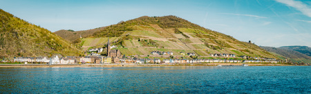 Beautiful view of the historic town of Lorchhausen with famous Rhine river on a scenic sunny day with blue sky in spring, Rheinland-Pfalz, Germany Фото со стока