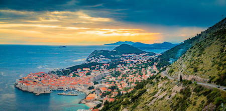 Panoramic aerial view of the historic town of Dubrovnik, one of the most famous tourist destinations in the Mediterranean Sea, in beautiful golden evening light at sunset, Dalmatia, Croatia Sajtókép
