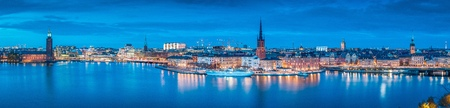 Panoramic view of famous Stockholm city center with historic Riddarholmen in Gamla Stan old town  and Stockholms Stadshuset district at dusk, Sodermalm, central Stockholm, Sweden
