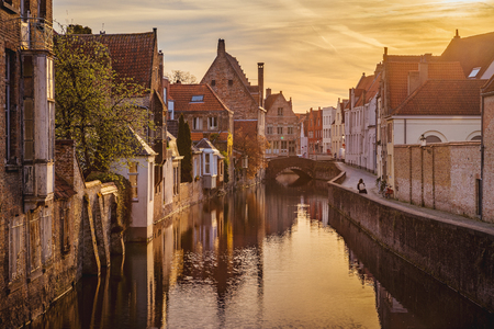 Classic postcard view of the historic city center of Brugge, often referred to as The Venice of the North, in beautiful golden morning light at sunrise, province of West Flanders, Belgium 写真素材 - 121794533