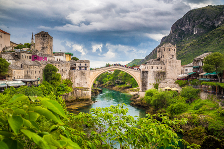 Panoramic aerial view of the historic town of Mostar with famous Old Bridge (Stari Most), a UNESCO World Heritage Site since 2005, on a rainy day with dark clouds in summer, Bosnia and Herzegovina Imagens