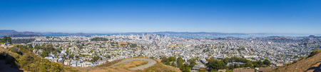 Beautiful panoramic view of San Francisco city skyline from Twin Peaks vista viewpoint on a scenic sunny day with blue sky, California, USA