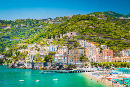 Scenic panoramic view of the beautiful town of Amalfi at famous Amalfi Coast with Gulf of Salerno in summer, Campania, Italy 스톡 콘텐츠 - 121794656