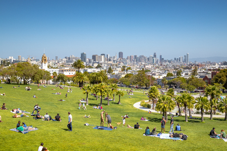 SEPTEMBER 4, 2016 - SAN FRANCISCO: Panorama view of people enjoying the sunny weather on a beautiful day with clear blue skies with the skyline of San Francisco in the background, California, USA