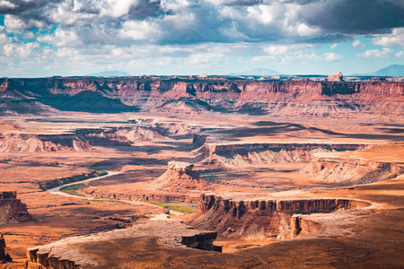 Scenic Green River overlook with dramatic clouds and blue sky on a sunny day in beautiful Canyonlands National Park, Utah, USA