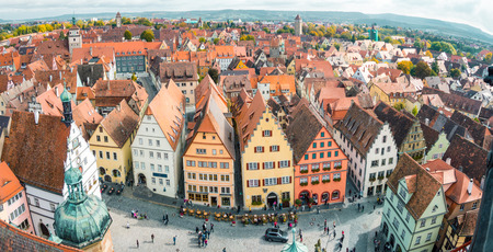 Aerial view of the medieval town of Rothenburg ob der Tauber on a beautiful sunny day with blue sky and clouds in summer, Bavaria, Germany Stock fotó
