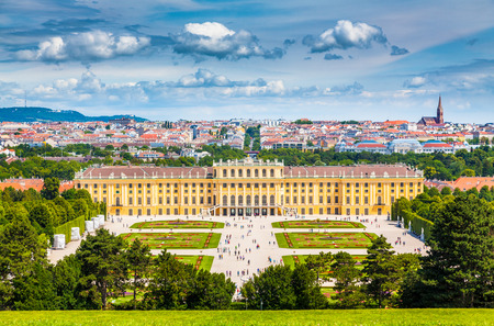 Classic view of famous Schonbrunn Palace with scenic Great Parterre garden on a beautiful sunny day with blue sky and clouds in summer, Vienna, Austria Redakční