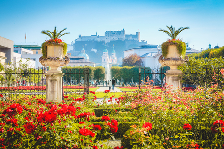 Classic view of famous Mirabell Gardens with historic Hohensalzburg Fortress in the background on a sunny day in fall in Salzburg, Austria