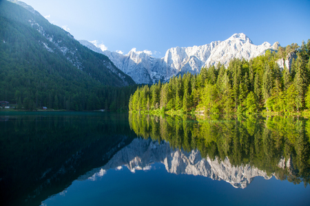 Beautiful tranquil morning view of famous Laghi di Fusinee in scenic morning light at sunrise, province of Udine, Friuli-Venezia Giulia, northern Italy Stock Photo