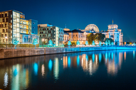 Panoramic twilight view of famous Berlin government district with Spree river during blue hour at dusk, central Berlin Mitte, Germany