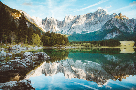 Beautiful morning view of famous Superior Fusine Lake with Mount Mangart in the background at sunrise, Tarvisio, Udine province, Friuli Venezia Giulia, Italy Stok Fotoğraf