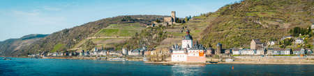 Beautiful view of the historic town of Kaub with famous Burg Pfalzgrafenstein along Rhine river on a scenic sunny day with blue sky in spring, Rheinland-Pfalz, Germany