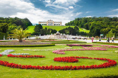 Classic view of famous Schonbrunn Palace with scenic Great Parterre garden on a beautiful sunny day with blue sky and clouds in summer, Vienna, Austria Sajtókép