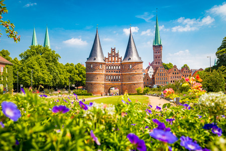 Classic postcard view of the historic town of L�beck with famous Holstentor gate in summer, Schleswig-Holstein, northern Germany Stock Photo - 121807034