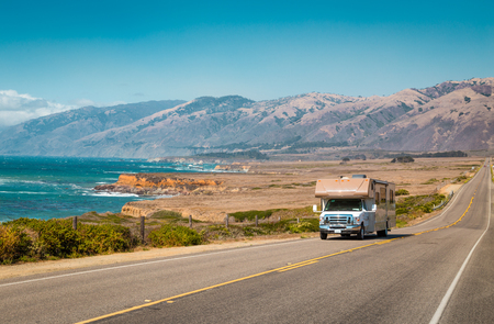 Panorama view of recreational vehicle driving on famous Highway 1 along the beautiful Central Coast of California, Big Sur, USA