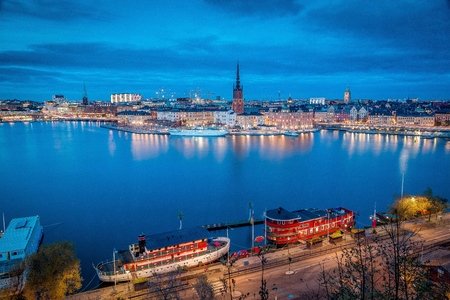 Panoramic view of famous Stockholm city center with historic Riddarholmen in Gamla Stan old town district during blue hour at dusk, Sodermalm, central Stockholm, Sweden