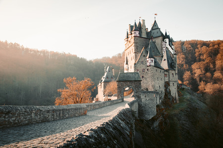 Beautiful view of famous Eltz Castle in scenic golden morning light at sunrise with blue sky on a sunny day in fall with retro vintage VSCO style filter effect, Wierschem, Rheinland-Pfalz, Germany Stok Fotoğraf - 121807038