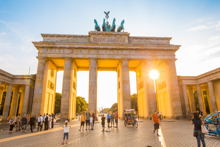 Brandenburg Gate, one of the best-known landmarks and national symbols of Germany, in beautiful golden evening light, Berlin, Germany. 新聞圖片