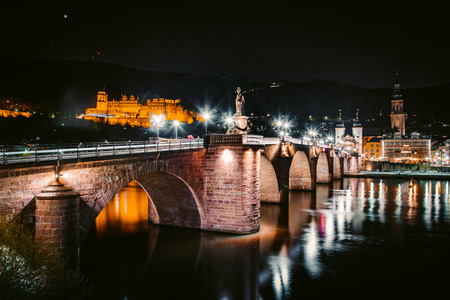 Panoramic view of the old town of Heidelberg reflecting in beautiful Neckar river at night, Baden-Wuerttemberg, Germany Editorial