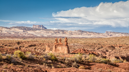 Panoramic view of stunning Hoodoos sandstone formations in famous Goblin Valley State Park on a beautiful sunny day with blue sky and clouds in summer, Utah, USA