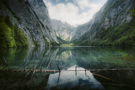 Scenic Lake Obersee on a beautiful day with blue sky and clouds in summer, Berchtesgadener Land. Upper Bavaria, Germany 写真素材
