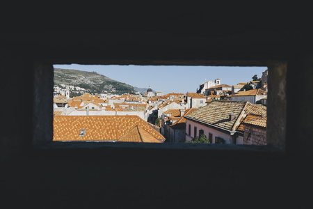Panoramic view of the old town of Dubrovnik in beautiful golden evening light at sunset with blue sky in summer, Dalmatia, Croatia