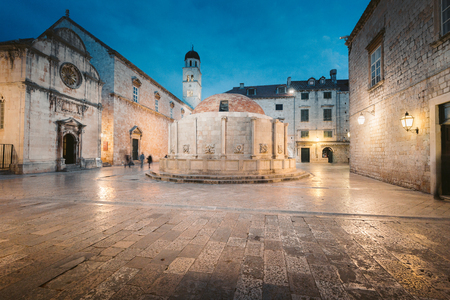 Beautiful twilight view of the historic town of Dubrovnik with famous Onofrio's fountain at dusk , Dalmatia, Croatia