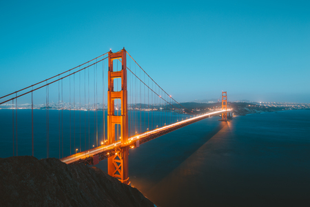 Classic panoramic view of famous Golden Gate Bridge seen from Battery Spencer viewpoint in beautiful post sunset twilight during blue hour at dusk in summer, San Francisco, California, USA Stock Photo