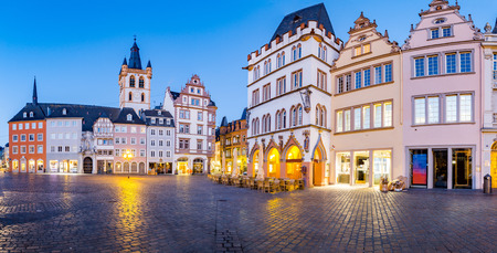 Historic city center of Trier with famous Hauptmarkt market square and St. Gangolf church in beautiful post sunset twilight at dusk in summer, Rheinland-Pfalz, Germany Stok Fotoğraf