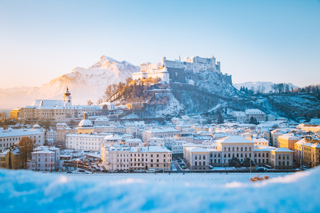 Classic view of the historic city of Salzburg with famous Hohensalzburg Fortress and Salzach river in scenic morning light at sunrise on a beautiful cold sunny day in winter, Salzburger Land, Austria Sajtókép