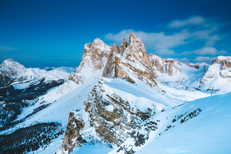 Classic view of famous Seceda mountain peaks in the Dolomites in beautiful evening twilight at dusk in winter, South Tyrol, Italy