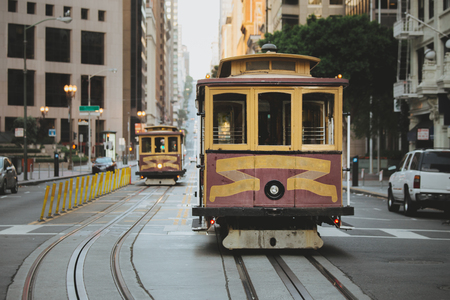 Beautiful view of traditional historic San Francisco Cable Cars on famous California Street in the early morning with retro vintage pastel toned filter effect, central San Francisco, California, USA