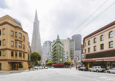 Central San Francisco with famous Transamerica Pyramid and historic Sentinel Building at Columbus Avenue on a cloudy day, California, USA
