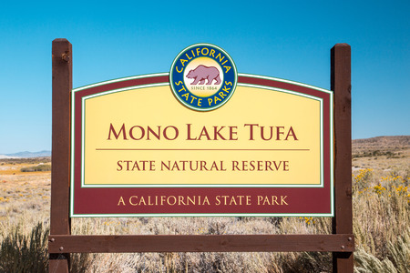 Mona Lake Tufa State Park entrance sign on a beautiful sunny day with blue sky in summer, Mono County, California, USA
