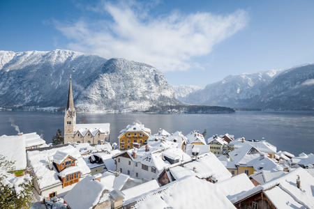 Panoramic aerial view of famous Hallstatt lakeside town during winter sunrise on a beautiful cold sunny day at Christmas time, Salzkammergut, Austria Reklamní fotografie