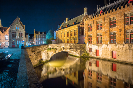 Classic panoramic twilight view of the historic city center of Brugge during beautiful evening blue hour at dusk, province of West Flanders, Belgium 스톡 콘텐츠