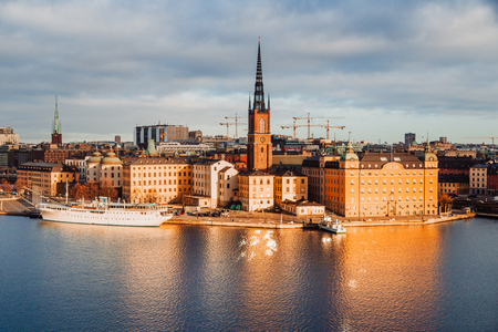 Classic view of Stockholm city center with famous Riddarholmen in Gamla Stan in beautiful golden morning light, Sodermalm, central Stockholm, Sweden