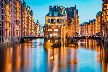 Classic view of famous Speicherstadt warehouse district, a UNESCO World Heritage Site since 2015, illuminated in beautiful post sunset twilight at dusk, Hamburg, Germany Reklamní fotografie