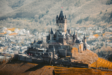 Beautiful aerial view of the historic town of Cochem with famous Reichsburg castle on top of a hill on a sunny day with blue sky in spring, Rheinland-Pfalz, Germany