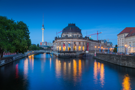 Beautiful view of famous Bode Museum at historic Museumsinsel (Museum Island) with TV tower and Spree river in twilight during blue hour at dusk, Berlin, Germany 報道画像