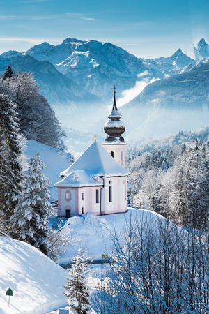 Beautiful winter wonderland mountain scenery in the Alps with pilgrimage church of Maria Gern, Berchtesgadener Land, Bavaria, Germany
