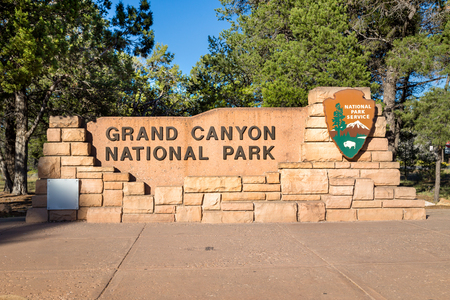 Grand Canyon National Park entrance monument sign on a beautiful sunny day with blue sky in summer, Arizona, USA Banco de Imagens - 121807081