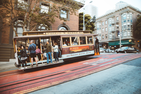 Traditional Powell-Hyde cable car riding in central San Francisco with motion blur California, USA