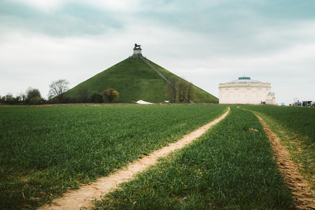 Panorama view of famous Lions Mound (Butte du Lion) memorial site, a conical artificial hill located in the municipality of Braine-lAlleud comemmorating the battle of Waterloo, on a moody day with d
