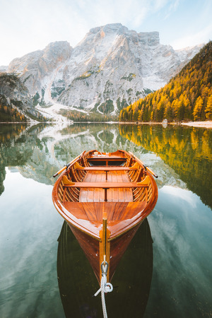 Beautiful view of traditional wooden rowing boat on scenic Lago di Braies in the Dolomites in scenic morning light at sunrise, South Tyrol, Italy Stock Photo
