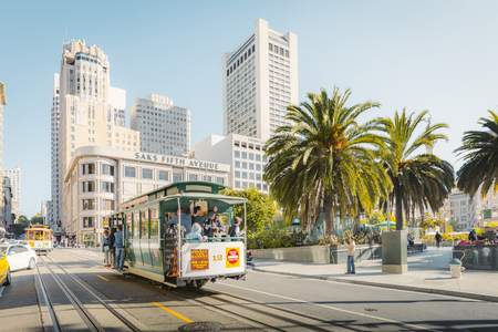 Traditional Powell-Hyde cable cars at Union Square in central San Francisco in beautiful golden morning light, California, USA