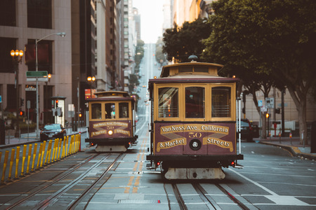 Classic panorama view of historic San Francisco Cable Cars on famous California Street at sunset with retro vintage Instagram style VSCO filter effect, central San Francisco, California, USA