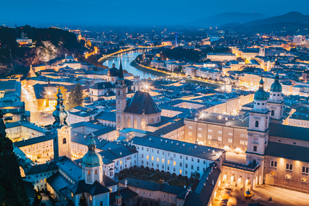 Classic twilight view of the historic city of Salzburg during blue hour at dusk in summer, Salzburger Land, Austria
