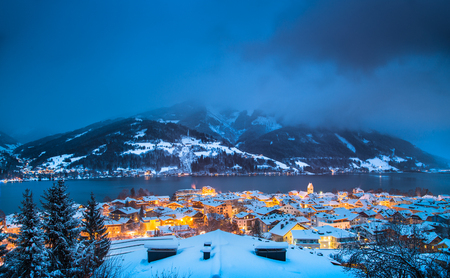 Panoramic view of Zell am See with Zeller See lake in twilight during blue hour at dusk in winter, Salzburger Land, Austria