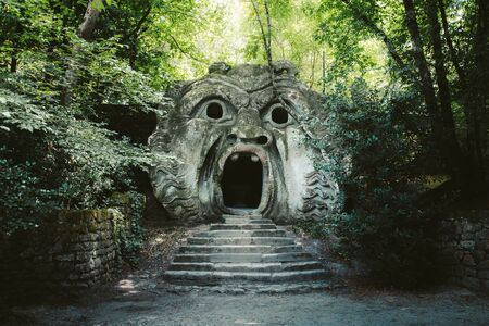 Orcus mouth sculpture at famous Parco dei Mostri (Park of the Monsters), also named Sacro Bosco (Sacred Grove) or Gardens of Bomarzo in Bomarzo, province of Viterbo, northern Lazio, Italy